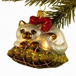 Glaskugle- Kat ligger på pude